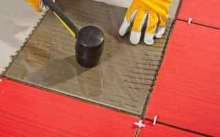 Casa e immobili: posa piastrelle  pavimento